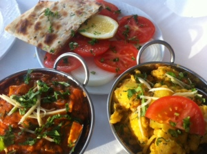 Paneer Jalfrezi (left) and Aloo Gobi, with a tomato and onion salad and a nan bread (Ganga)